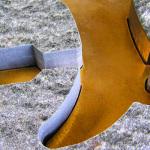 Intarsienarbeit für ein bekanntes Schuhhaus aus Natursteinen und einem eingesetzten Firmenlogo aus Messing.